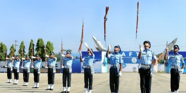 The Air Warrior Drill Team of the Indian Air Force perform a routine during a passing out parade of Aeronautical...