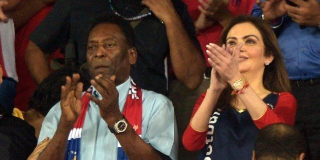 Former Brazilian footballer Pele (L) and Indian business woman, Nita Ambani watch the Indian Super League...