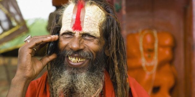 Sadhu man with mobile