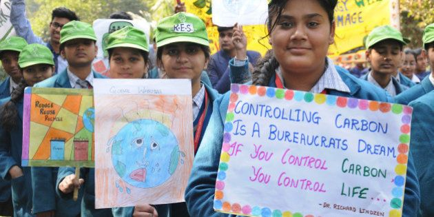 NEW DELHI, INDIA - DECEMBER 30: School children took out a rally in support of the odd-even formula introduced...