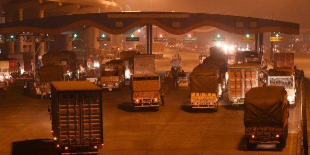 In this photograph taken late November 14, 2015, shows a general view of trucks entering New Delhi at...