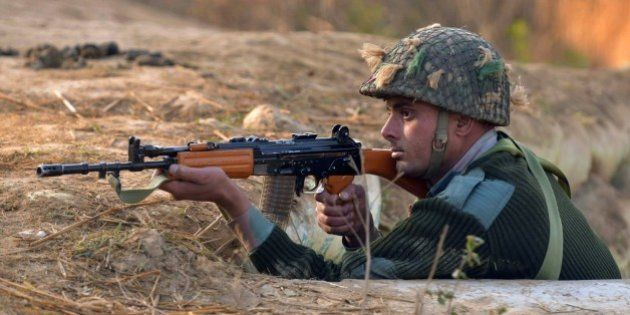 An Indian army soldier takes up position on the perimeter of an airforce base in Pathankot on January...