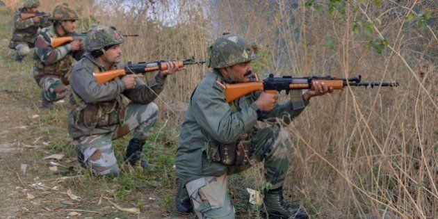 Indian army soldiers take up position on the perimeter of an airforce base in Pathankot on January 3,...