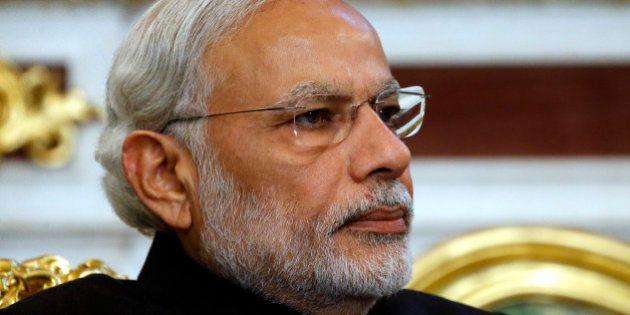 Indian Prime Minister Narendra Modi listens to Russian President Vladimir Putin in the Kremlin, in Moscow,...