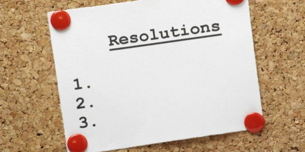 A blank list of resolutions for new year or in general pinned to a cork notice board with room for your