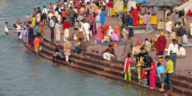 The amazing colour and intensity of pilgrims bathing in the holy Ganga at the Har-ki-Pairi ghats in Haridwar....