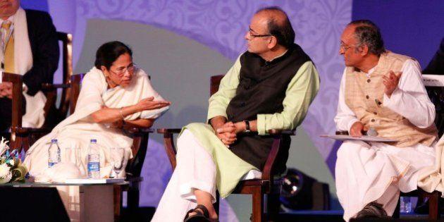 KOLKATA, INDIA - JANUARY 8: Finance Minister Arun Jaitley, West Bengal Chief Minister Mamata Banerjee...