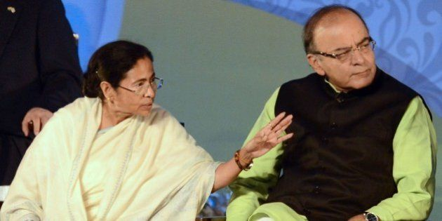 The Chief Minister of the Indian state of West Bengal Mamata Banerjee (L) gestures as Indian Union Finance...