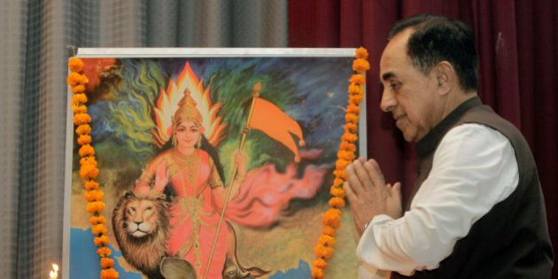 Opposition Janata Party President Subramanian Swamy folds his hand in reverence after a traditional lamp...