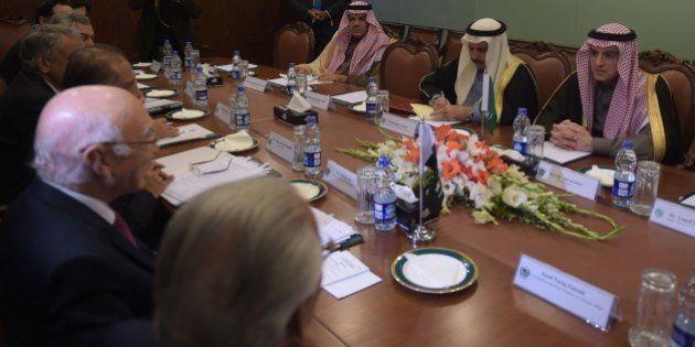 Saudi Minister of Foreign Affairs Adel al-Jubeir (R) listens as Pakistan's National Security Advisor...