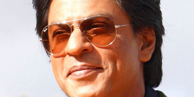 Indian actor Shahrukh Khan poses for photographers at the Marrakech International Film Festival in Marrakech,...