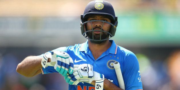 PERTH, AUSTRALIA - JANUARY 12: Rohit Sharma of India walks from the field at the end of the innings during...