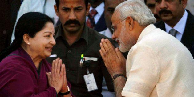 Tamil Nadu state Chief Minister J. Jayalalithaa, left, greets Bharatiya Janata Party (BJP) leader Narendra...