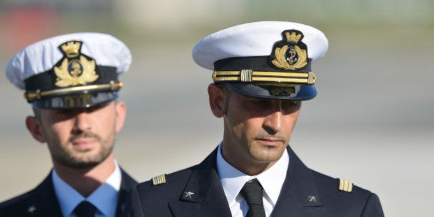 (FILES) In this photograph taken on December 22, 2012, Italian marines Massimiliano Latorre (R) and Salvatore...