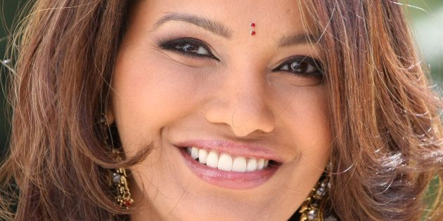 Former Miss World 1997, Diana Hayden of India poses for photographers during the MIPTV (International...