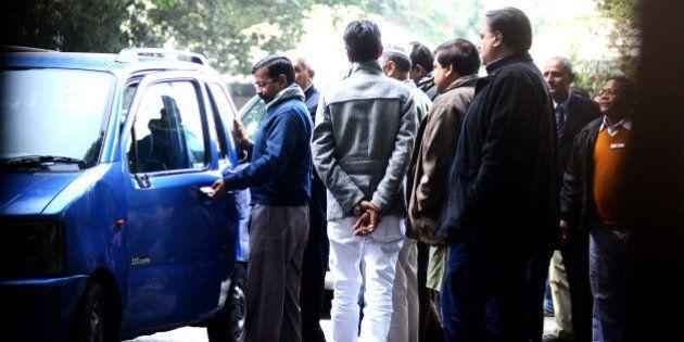 NEW DELHI, INDIA - DECEMBER 24: Delhi Chief Minister, Arvind Kejriwal, getting into his old Maruti wagon...