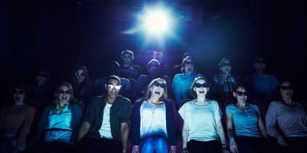 Group of people wearing 3D glasses at the