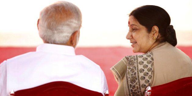 NEW DELHI, INDIA - JUNE 19: Prime Minister Narendra Modi talking with External Affairs Minister Sushma...