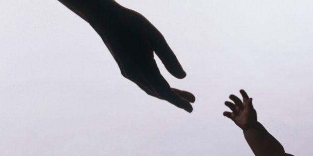 Silhouette of baby's hands reaching for