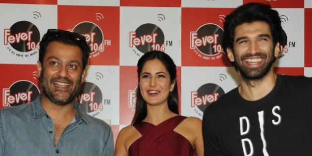 Indian Bollywood actors Katrina Kaif (C) and Aditya Roy Kapur (R) pose for a photograph during a promtional...