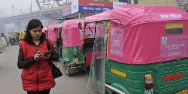 Gurgaon, India - January 1: Pink autos for women commuters which are yet to be launched but are ferrying...