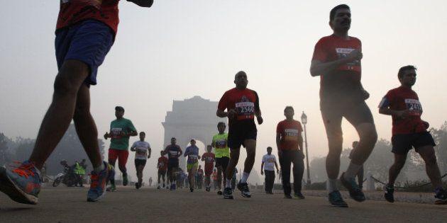 NEW DELHI, INDIA - NOVEMBER 29: Runners take part in Airtel Delhi Half Marathon 2015 at Rajpath in the...