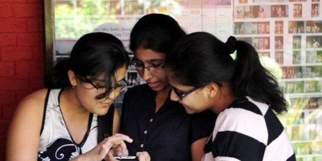 NEW DELHI, INDIA - MAY 30: Students checking their CBSE class 10 examination result on mobile on May...