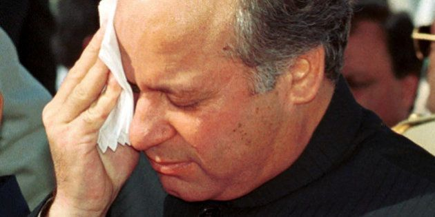 FILE-Nawaz Sharif, deposed prime minister of Pakistan, wipes his face in this August 14, 1999 file photo....