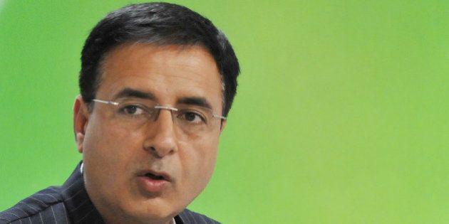 NEW DELHI, INDIA - MARCH 18: Congress spokesperson Randeep Singh Surjewala (L) address the media at AICC...