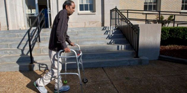 Sureshbhai Patel steadies himself with a walker as he arrives at the federal courthouse before start...