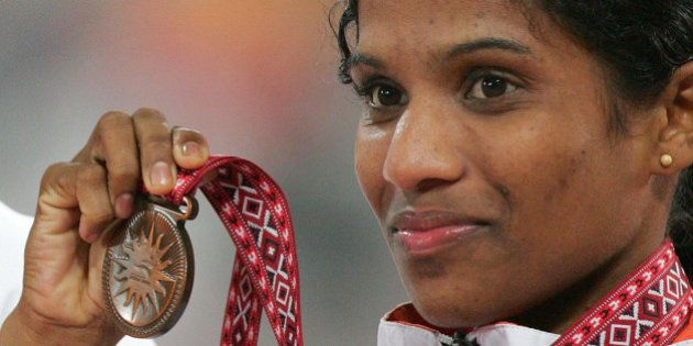 India's P. Jaisha Orchatteri holds the bronze medal for the final of the Women's 5000m at the Asian Games...