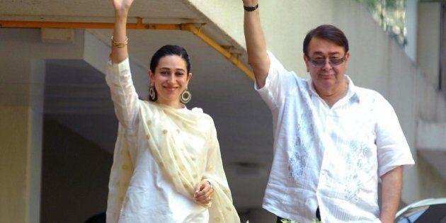 'MUMBAI, INDIA - OCTOBER 16: Randhir Kapoor and Karisma Kapoor appear on the balcony after the Saif-Kareena's...