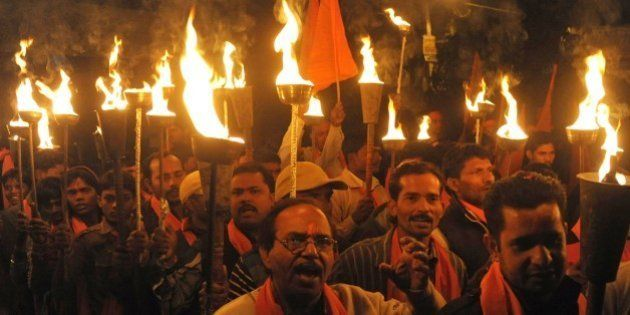 Indian activists of the Hindu Bajrang Dal Party hold torches during a procession marking the 22nd anniversary...