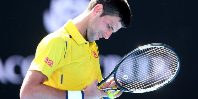 MELBOURNE, AUSTRALIA - JANUARY 18: Novak Djokovic of Serbia reacts in his first round match against Hyeon...