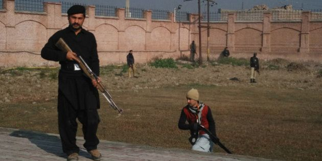 This photograph taken from a mobile phone shows Pakistani security personnel taking position outside...
