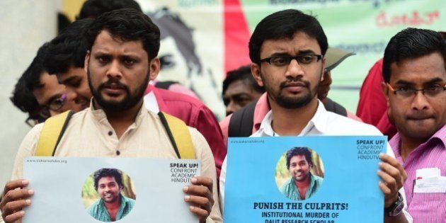 Members of the Students Christian Movement of India and other activists stage a protest in Bangalore...