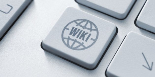 Computer button on a keyboard with wiki encyclopedia icon