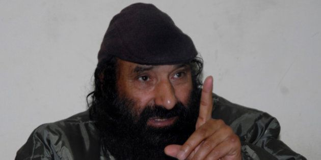 Syed Salahuddin, head of Kashmiri militant group Hizb-ul-Mujahedin, gestures during a press conference...