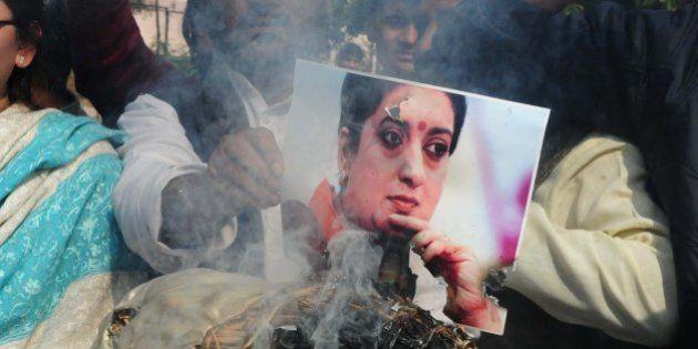 BHOPAL, INDIA - JANUARY 20: Congress workers burning an effigy of union HRD Minister Smriti Irani while...