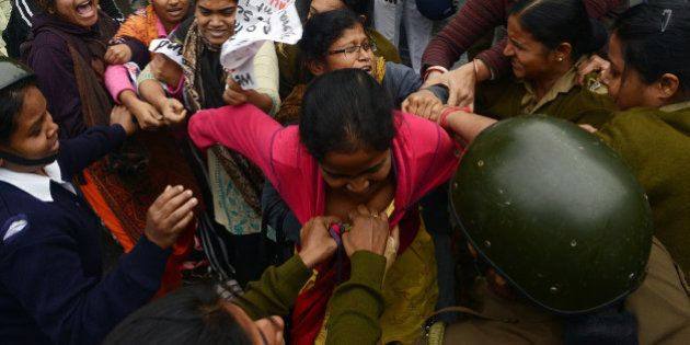 Leftist student activists tussle with police prior to getting arrested during a protest rally in Kolkata...