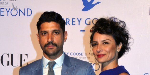 Indian Bollywood actor Farhan Akhtar (L) poses with his wife actress Adhuna Akhtar during the Grey Goose...