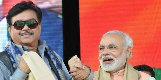PATNA, INDIA - OCTOBER 27: Gujarat CM and BJP's prime ministerial candidate Narendra Modi with Shatrughan...