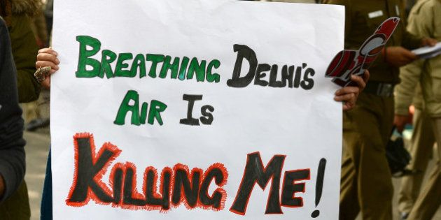 Social activists hold placards during an awareness rally against air pollution under the banner, 'Help...