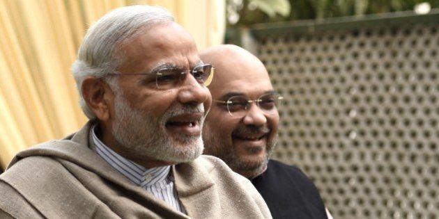 NEW DELHI, INDIA - NOVEMBER 28: Prime Minister Narendra Modi and BJP President Amit Shah arrive to attend...