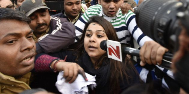 NEW DELHI, INDIA - JANUARY 17: A woman (C) who threw ink on Chief Minister Arvind Kejriwal (Not in Picture)...