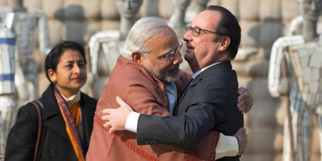 Indian Prime Minister Narendra Modi, left and French President Francois Hollande greet each other at...