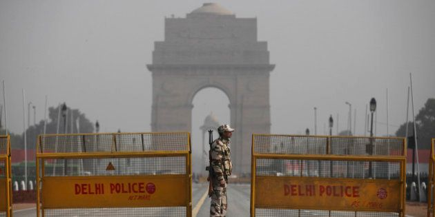 An Indian paramilitary soldier stands guard near a police barricade in front of India Gate, the landmark...