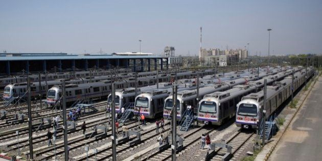 Metro coaches that will run on the Badarpur-Faridabad extension of the Delhi Metro are seen at a depot on the outskirts of New Delhi, India, Thursday, April 9, 2015. The line, which will be an extension of the currently operational violet line between Mandi House and Badarpur will take the Metro to the satellite city of Faridabad in Haryana for the first time, a Delhi Metro Rail Corporation press release said. (AP Photo/Altaf Qadri)