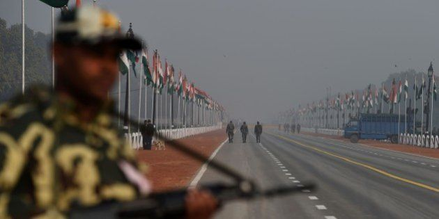 An Indian soldier keeps a look out on Rajpath ahead of the forthcoming Republic day in New Delhi on January...
