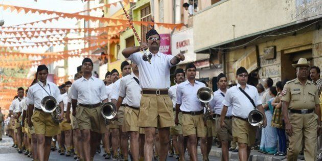 The band of Rashtriya Swayamsevak Sangh (RSS) take part in the 'Shrung Ghosh Path Sanchalan' (Route March...